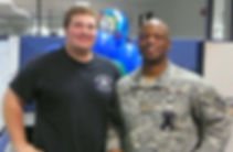 Jonathan and one of his close friends, Major Lofton, at work