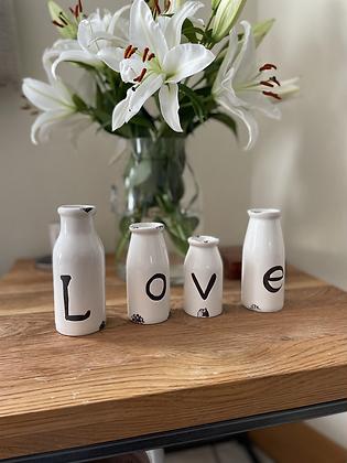 4 Decorative bottles spelling love