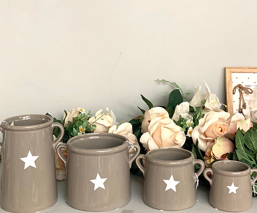 decorative grey enamel jugs stars