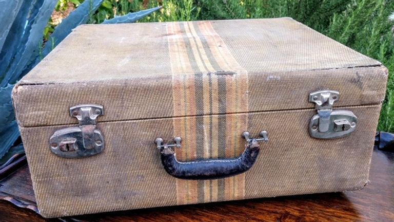 Vintage cloth striped suitcase