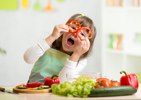kid girl having fun with food vegetables