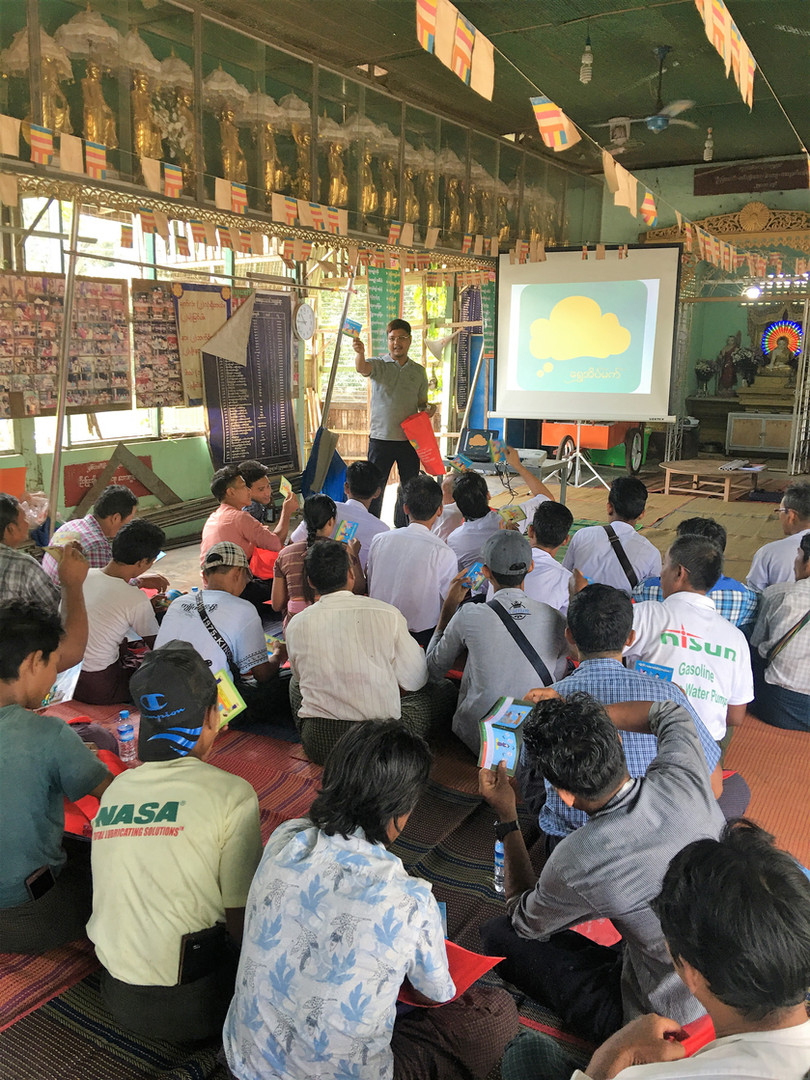 Outreach and Empowerment Officer Myint Maung Maung raises awareness about Golden Dreams at the first mile - rural Myanmar communities with high levels of outmigration