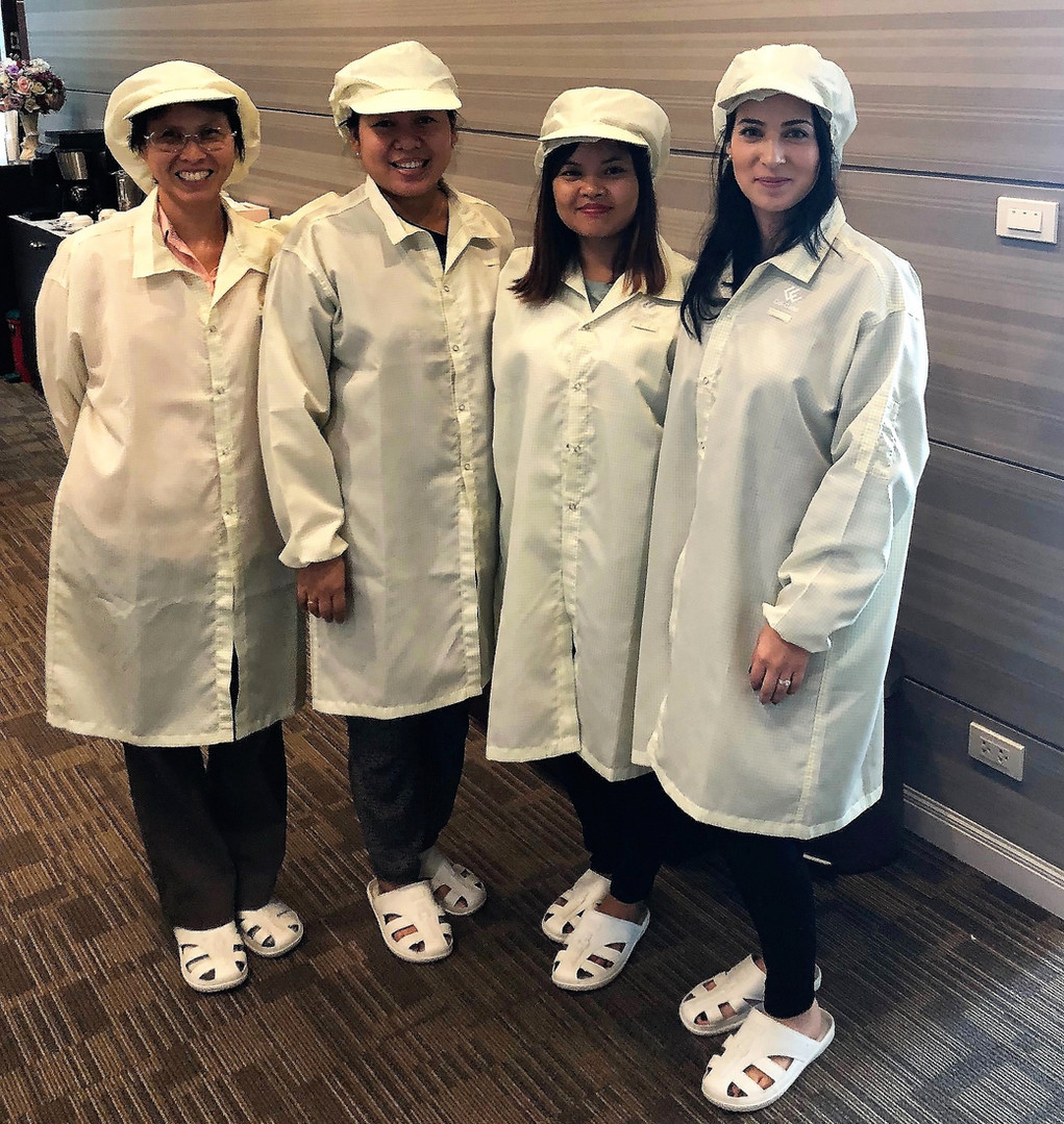 Sasi-On Kam-on, Khin Win Maw, Mya Marlar Oo, and Ana Maria Soto Bernal visit workers in a factory in the supply chain of Issara Strategic Partners