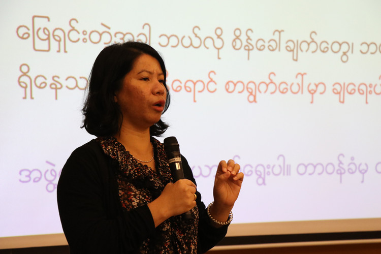 Outreach and Empowerment Officer Nang San Mon trains groups of Burmese workers in Thailand about their rights under the law, and what to do when they are violated