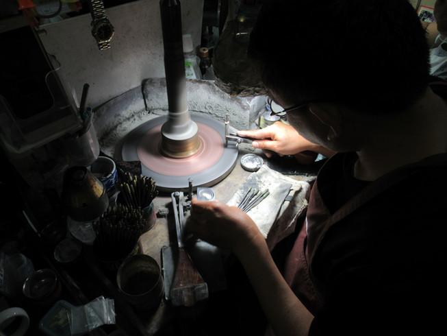 Polishing sapphires in the Bangkok workshop