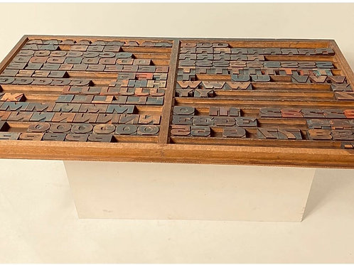 Antique typeset/printers drawer with wood letters, numbers, punctuation.