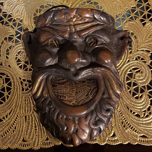 Small bronze mask
