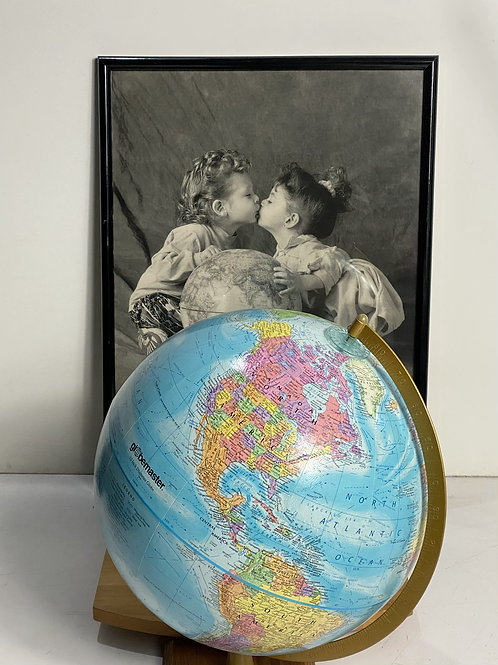 A Kids love make the world go around w/ globe