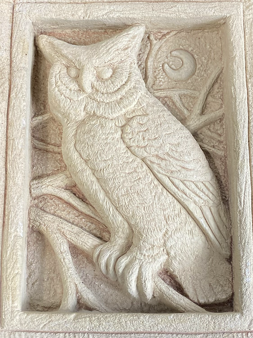 Stone carved owl