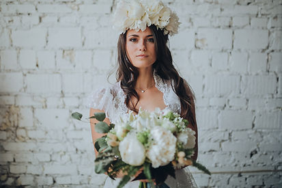 Wedding Photography of Bride with Floral Bouquet taken by Keyhole Studios wedding photography & film