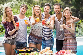 portrait-of-friends-having-juice-at-outd
