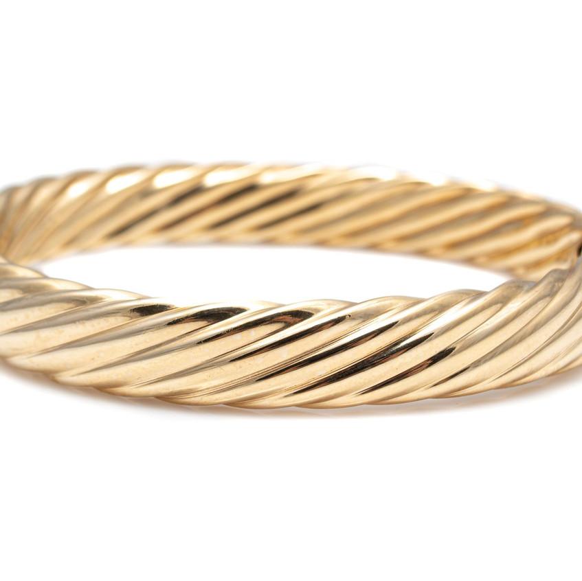 14 Karat Yellow Gold Hollow Bangle Brace