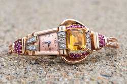rose gold with citrine, rubies, and diam