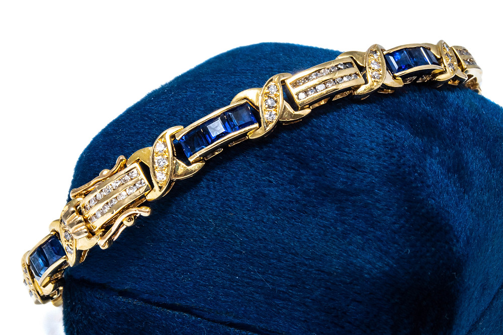 Diamonds and sapphires set in yellow gold