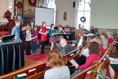 Sunday School children make Holiday Hope Chests
