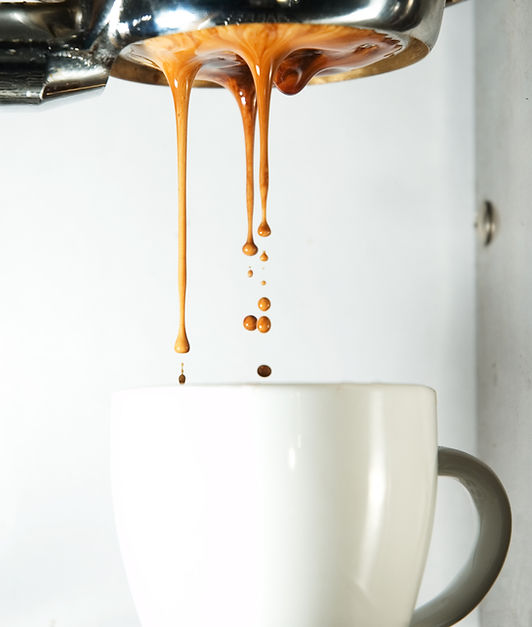 Coffee dripping into a cup.