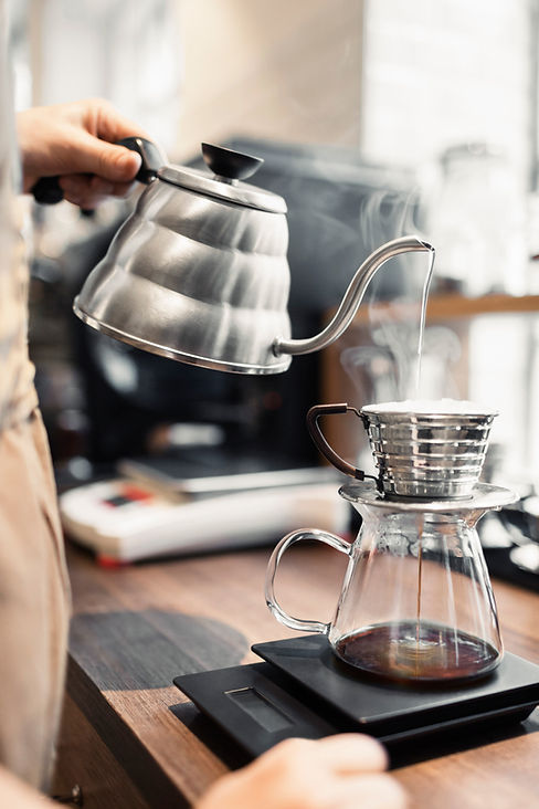 gooseneck kettle and water pouring into Kalita Wave