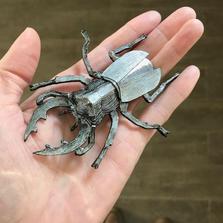 Stag beetle brooch