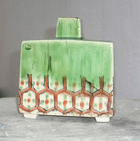 footed slab bottle vase