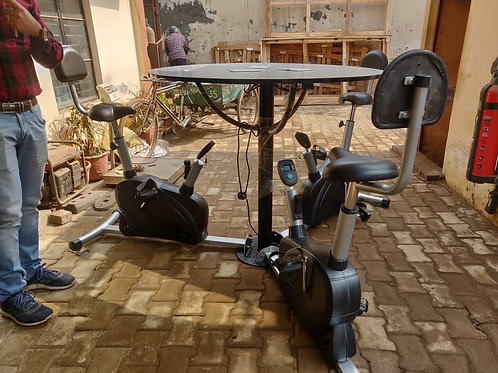 Conference table with 3 exercise bikes