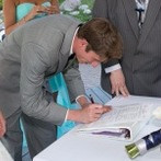 Kenneth J Kiwicz signs his signature on a document