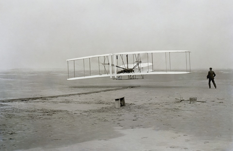 This is a picture of the Wright Brothers testing out flight on the beach.