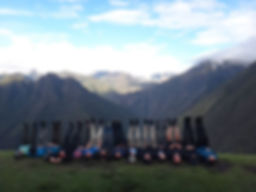Kenneth Kiwicz is with his team on the Inca Trail peering over the mountains in Peru