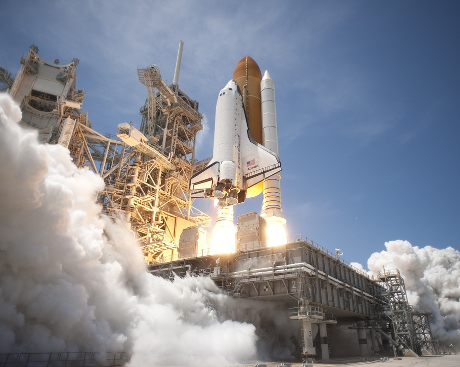 The space shuttle is launching from cape canaveral