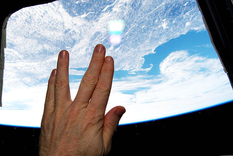This is a picture of a man in space doing the vulcan salute from the space station