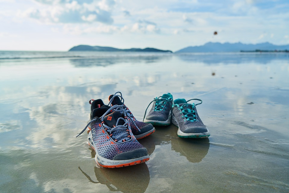 Someone stepped out of their comfort zone and out of their shoes on a beach