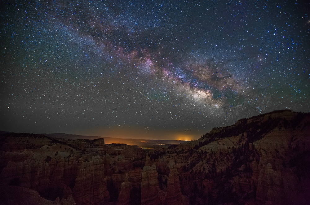 This is the star filled night sky over the grand canyon.