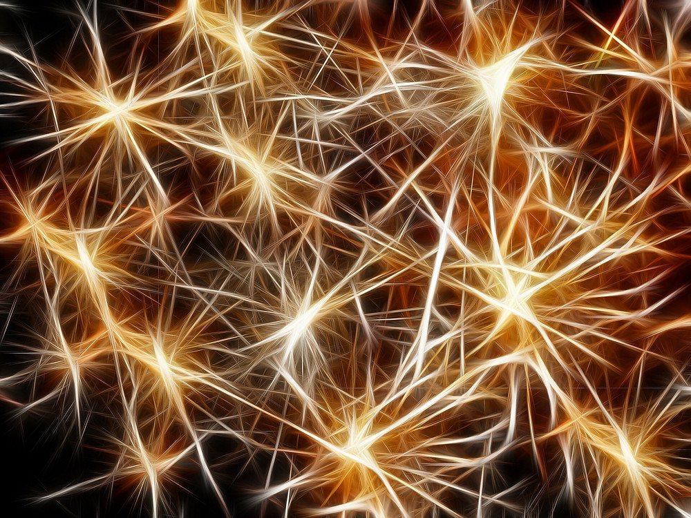 Neurons and neuro pathways light up like fireworks in the night sky