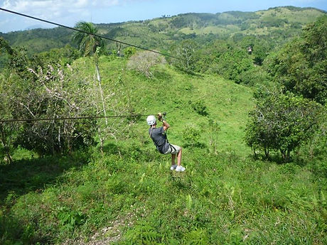 Kenneth Kiwicz rides a zip line in Dominican jungle
