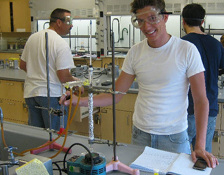 Kenneth Kiwicz demonstrates his ability to perform laboratory experiments in organic chemistry lab.