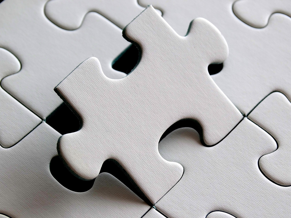 This is a picture of a puzzle piece fitting in.