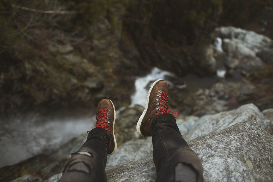 Kenneth Kiwicz picture of feet standing over water on a rocky outcrop