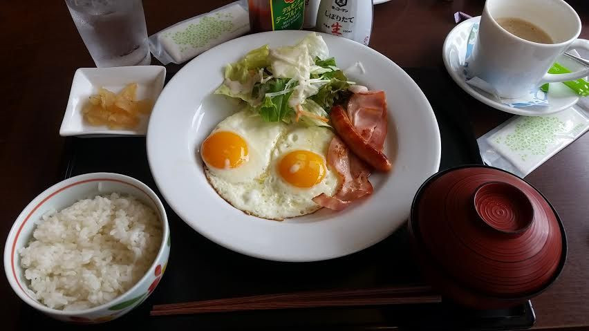 Japanese Denny's. Eggs, Ham, Salad, Miso soup, and rice...for breakfast!