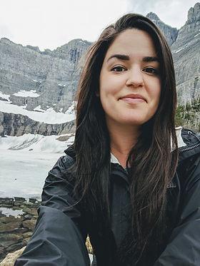 girl sitting at glacier national park