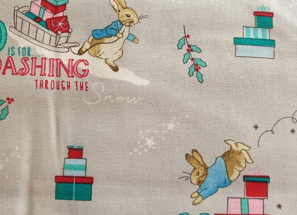 Peter Rabbit dashing through the snow cotton