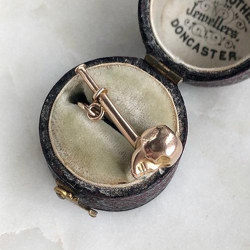Vintage gold skull pipe charm