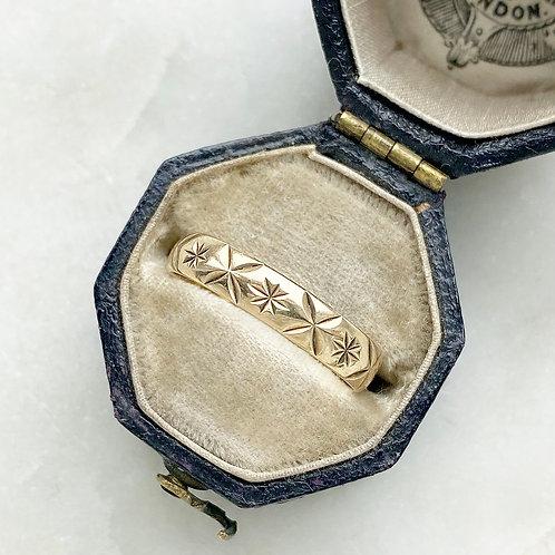 Vintage 9ct gold star pattern ring