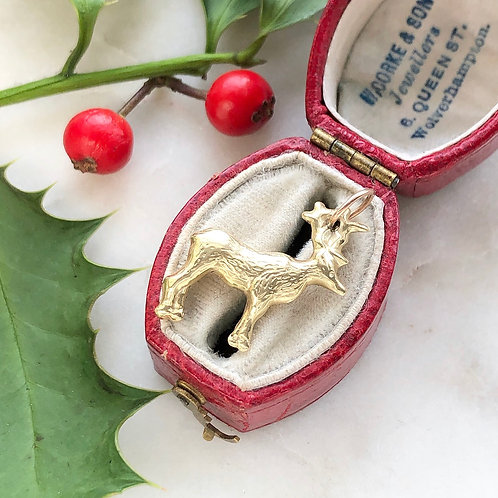 Vintage gold reindeer charm
