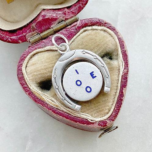 Vintage sterling silver and blue enamel 'I LOVE YOU' horseshoe spinner charm