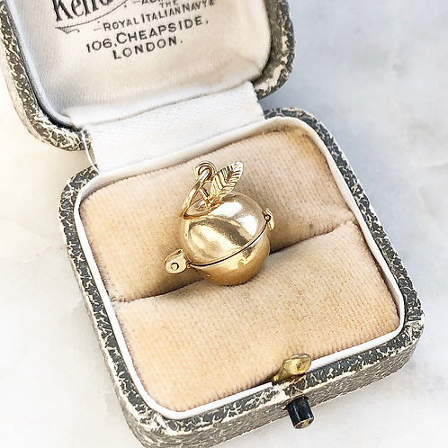 Vintage gold opening apple charm with Adam and Eve