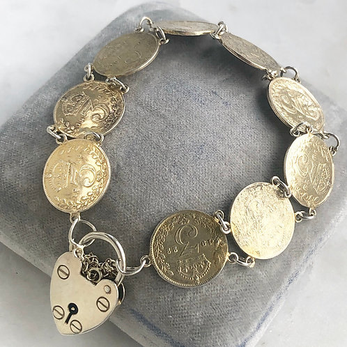 Vintage silver and gold wash British threepence coin padlock bracelet
