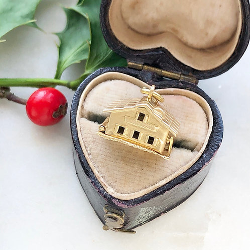 Vintage gold opening chalet charm with enamel hearts