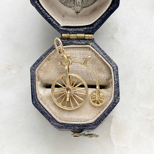Vintage 9ct gold moving penny farthing charm
