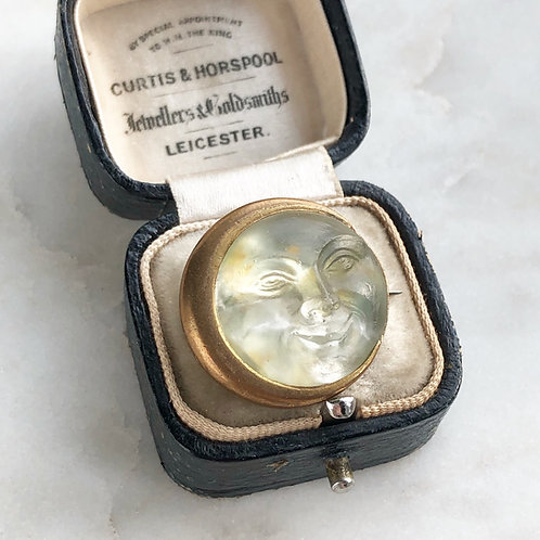 Antique man in the moon brooch