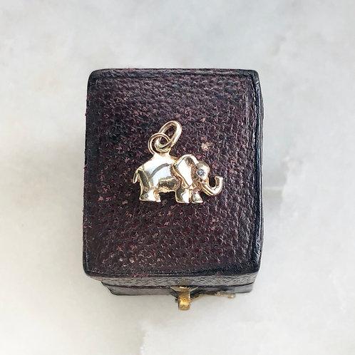 Vintage gold and diamond tiny elephant charm