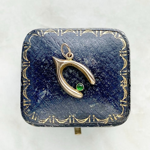 Vintage 9ct gold and green glass wishbone charm